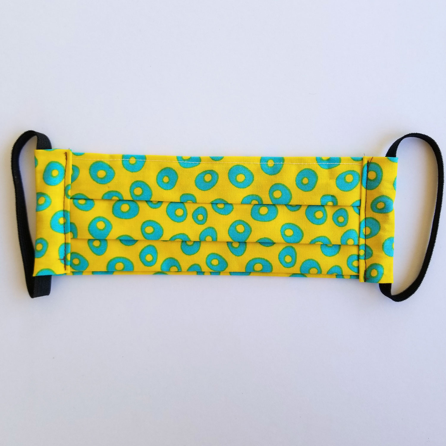 Handmade fabric mask in bright yellow with blue spots