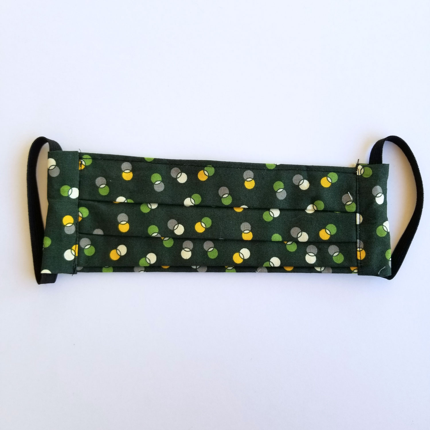 Handmade fabric mask in dark green print with circles